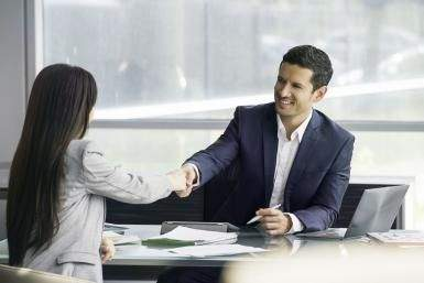 Businessman shaking hands with clien