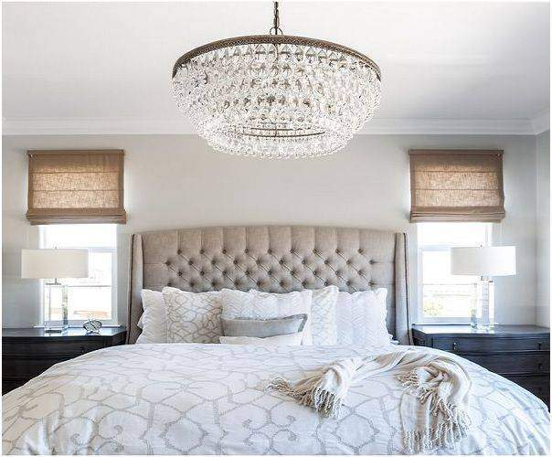A beautiful chandeliers in a bedroom - Shruti Sodhi Interior Designs