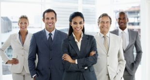 Happy confident business woman heading a team of successful colleagues
